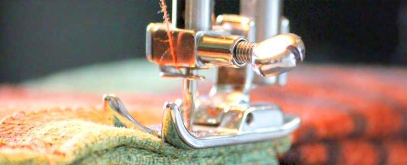 The needle of a sewing machine quilting